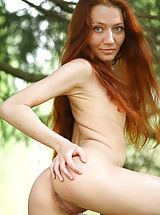 Tiny Boobs, Redhead skinny Kessy undresses, while posing somewhere outdoors