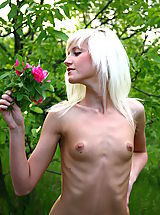 Very skinny blonde girl poses naked and shows her small tits during outdoor showoff.