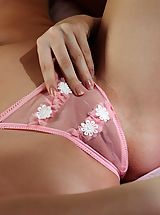 crotchless panties, Adele has a young pristine body and she has blonde hair up top and no hair down below.