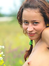 Tiny Breasts, Naked teen cutie gathering flowers in the field and artfully displaying her fresh sexy body.